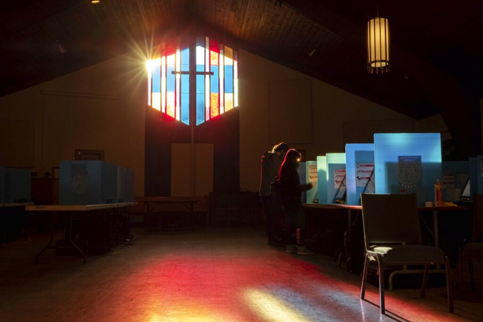 Voters mark their ballots at the Lawrenceville Road United Methodist Church in Tucker, Ga. during the Senate runoff election Tuesday.