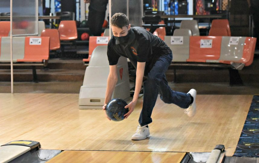 Mohonasen senior Andrew Cancilla releases his two-handed release on the approach Wednesday afternoon against Schalmont at Sportsman's Bowl in Schenectady.STAN HUDY/DAILY GAZETTE
