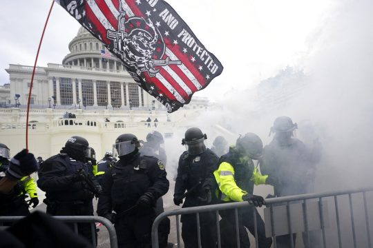 Police hold off Trump supporters who tried to break through a police barrier, Wednesday, Jan. 6, 2021, at the Capitol in Washington. (AP Photo/Julio Cortez)