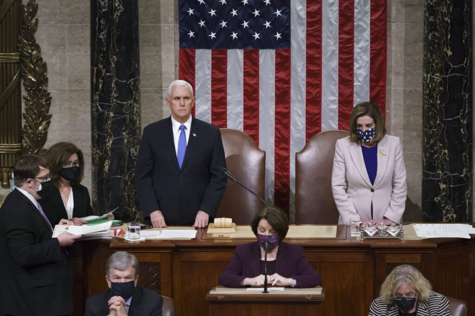 Vice President Mike Pence and Speaker of the House Nancy Pelosi, D-Calif., read the final certification of Electoral College votes