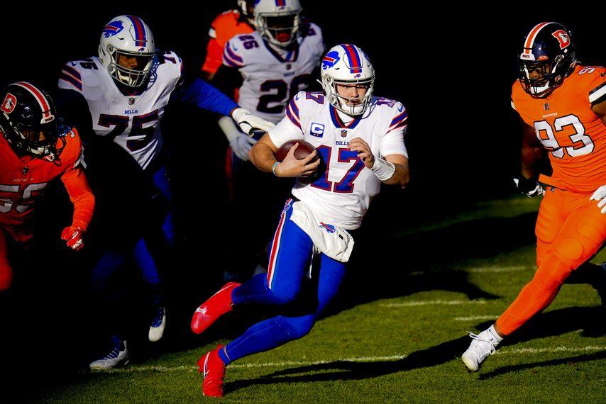 JACK DEMPSEY/THE ASSOCIATED PRESSBuffalo Bills quarterback Josh Allen runs through the Denver Broncos defense during their game in Denver on Dec. 19.