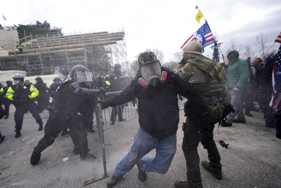Trump supporters try to break through a police barrier Wednesday