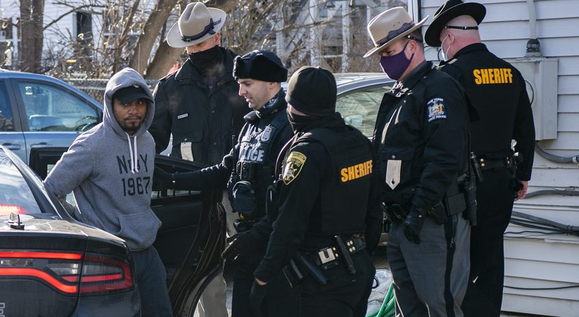The suspect of an armed robbery in Halfmoon is taken into custody by Saratoga County Sheriffs Deputies after leading several police agencies on achase Thursday.
