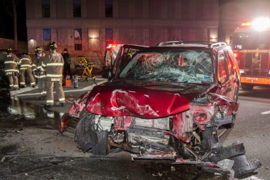 Schenectady firefighters work to free a driver on scene Dec. 29.