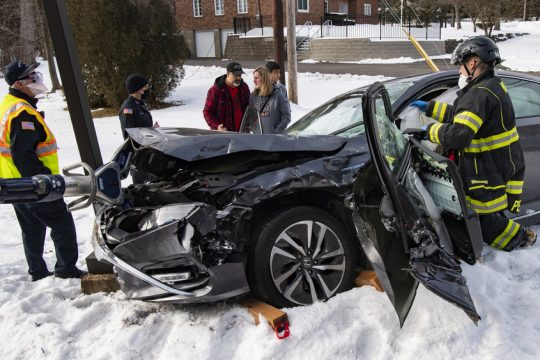 Niskayuna Fire District 1 firefighters Nicholas Persons, left, cuts away a deployed air bag to get to the driver of a car involved in a head on collision on Troy-Schenectady Road Saturday.