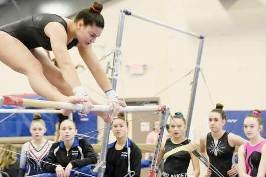 Saratoga Springs' Sophia Damiano competes on the uneven bars during last season's Saratoga Invitational high school gymnastics competition at the Saratoga Regional YMCA Wilton Branch on Jan. 11, 2020.