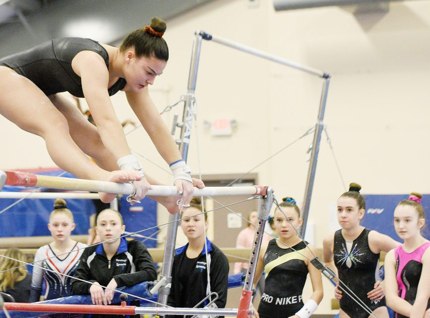 Saratoga Springs' Sophia Damiano competes on the uneven bars during last season's Saratoga Invitational high school gymnastics competition at the Saratoga Regional YMCA Wilton Branch on Jan. 11, 2020.