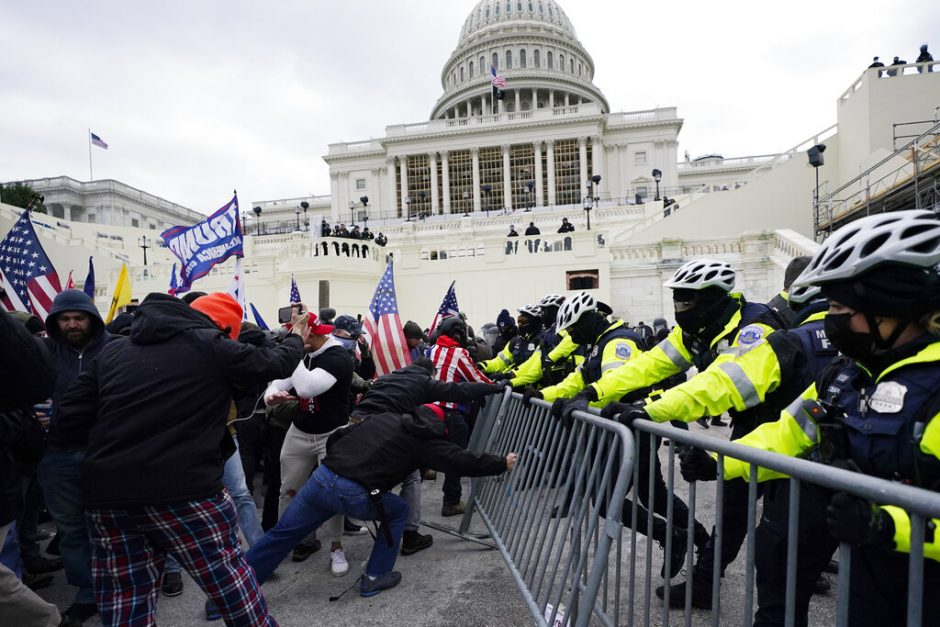 Trump supporters try to break through a police barrier at the Capitol Jan. 6