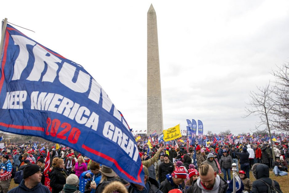 With the Washington Monument in the background, people attend a rally in support of President Donald Trump Jan. 6.