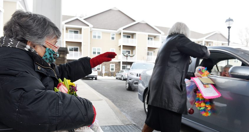 Marjorie Maas, aka Marvelous Marge, reacts to long-time friends drive up waving goodbye Monday