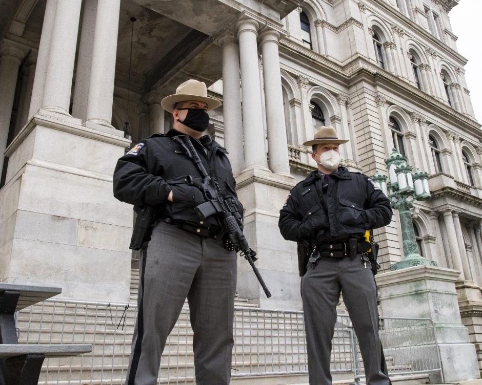 PETER R. BARBER/THEDaily GazetteState troopers guard the Swan Street entrance of the State Capitol building in Albany Tuesday.