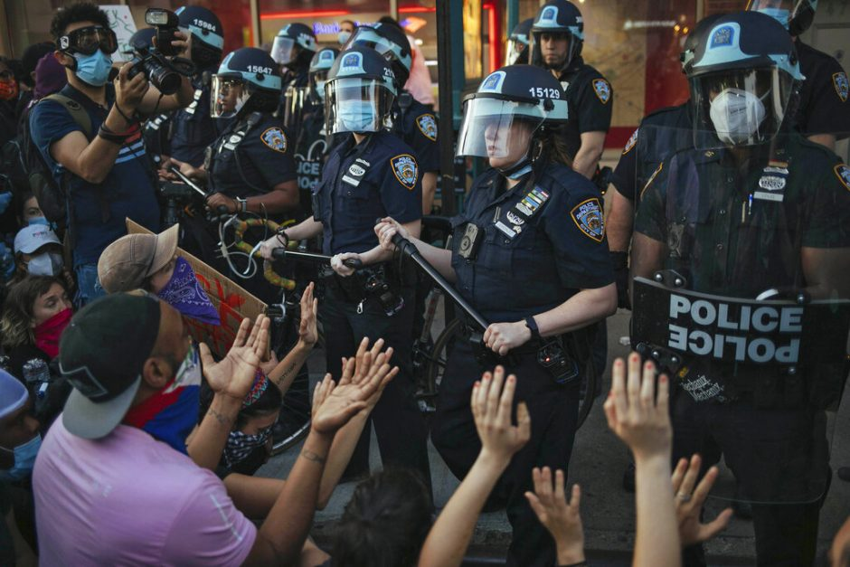 This May 31, 2020 file photo shows New York City Police facing off with activists during a protest march in the Bedford-Stuyvesant section of the Brooklyn