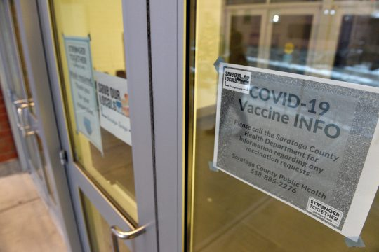 A sign with COVID-19 vaccine information is posted at the Saratoga Springs City Center on Thursday.