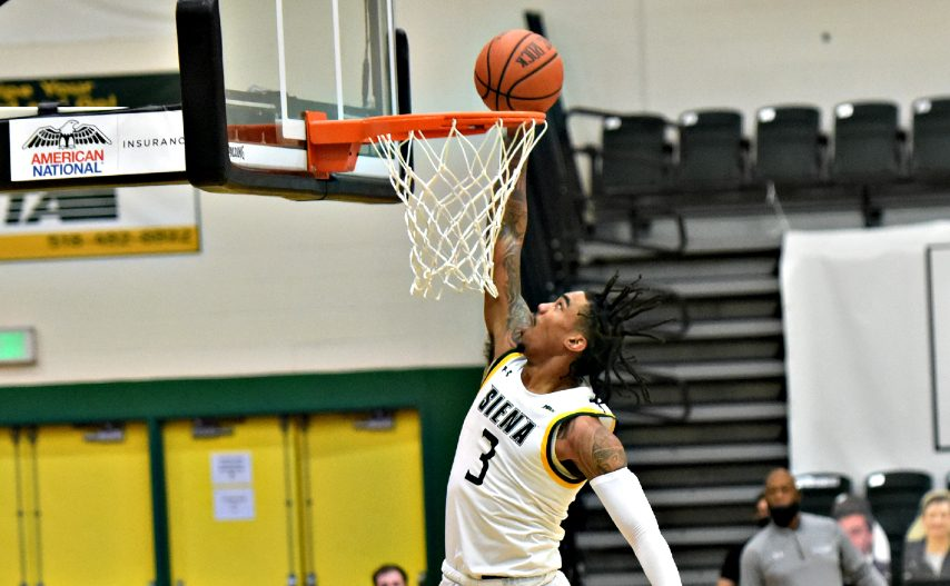 Manny Camper dunks during a game earlier this month. (Stan Hudy/The Daily Gazette)