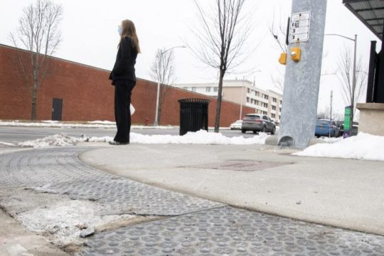 A pedestrian waits to cross at the intersection of Franklin and Lafayette streets in Schenectady Thursday.