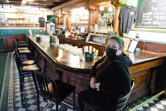 Parting Glass manager and daughter to owner Joan Desadora, Linda DiBlasio, of Saratoga Springs, inside their bar while closed to business on Wednesday after hearing they received funding from The Barstool Fund to help keep their business open throughout the COVID-19 pandemic.