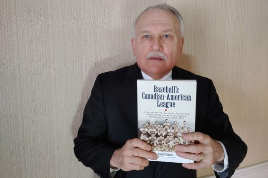"""Author Dave Pietrusza of Glenville holds his book """"Baseball's Canadian-American League,"""" in which he documents some of the exploits of Tommy LaSorda as a pitcher for the Schenectady Blue Jays."""