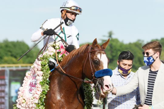 ERICA MILLER/STAFF PHOTOGRAPHER   Improbable, trained by Bob Baffert and ridden by Irad Ortiz, Jr, after winning the 93rd running of Grade I Whitney Stakes at Saratoga Race Course in Saratoga Springs on Saturday, August 1, 2020.