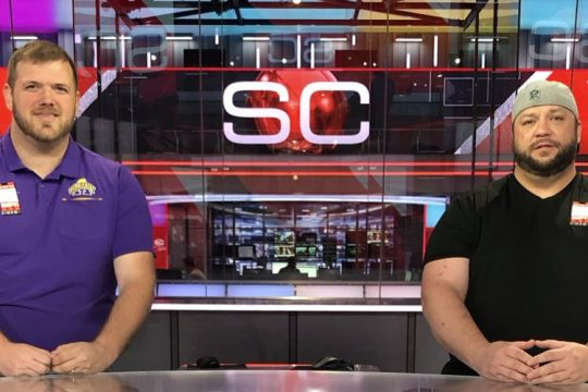 "Tom Goslowski, left, and Jeff Levack pose at the ESPN ""SportsCenter"" studio in Bristol, Conn. Goslowski, who was co-host of ""Levack and Goz"" and was the brand manager for 104.5 The Team, was let go by the station on Monday. (Tom Goslowski Twitter photo)"