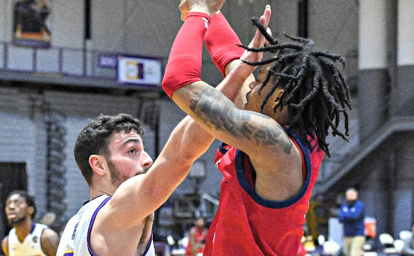 UAlbany's Antonio Rizzuto, left, contests a shot from NJIT's Zach Cooks during Saturday's game in Albany. (Bob Mayberger/UAlbany Athletics)
