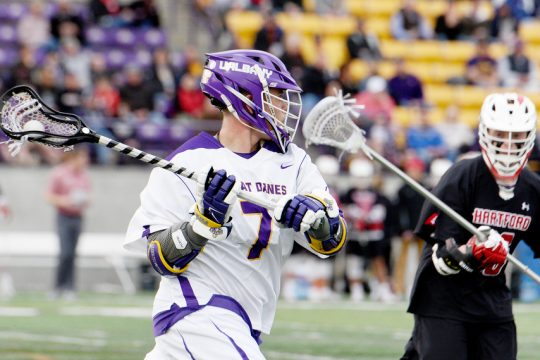 ERICA MILLER/GAZETTE PHOTOGRAPHER UAlbany's Mitch Laffin handles the ball during a game against Hartford at Casey Stadium on March 30, 2019.