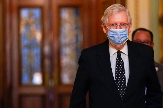 Senate Majority Leader Mitch McConnell of Ky., walks from the Senate floor to his office on Capitol Hill Jan. 6