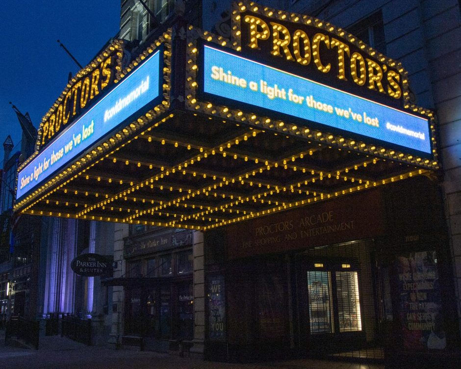 """PETER R. BARBER/THE DAILY GAZETTEThe Proctors Theatre marquee in Schenectady sends a message to""""Shine a light for those we've lost"""" on Tuesday as COVID-19 deaths in the United States surpassed 400,000."""