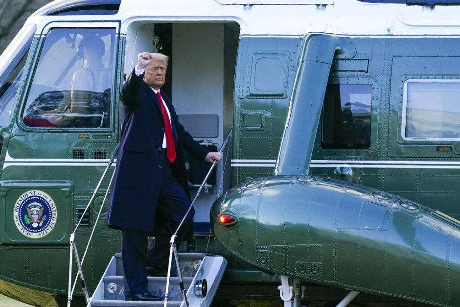 President Donald Trump gestures as he boards Marine One on the South Lawn of the White House, Wednesday, Jan. 20, 2021, in Washington. Trump is en route to his Mar-a-Lago Florida Resort.