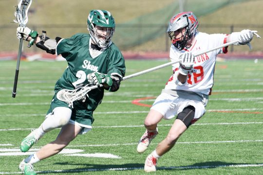 ERICA MILLER/THE DAILY GAZETTEShenendehowa's Billy Beach with the ball against Niskayuna's Noah Wattsottonsen during their Suburban Council boys' lacrosse game April 6 at Union College.