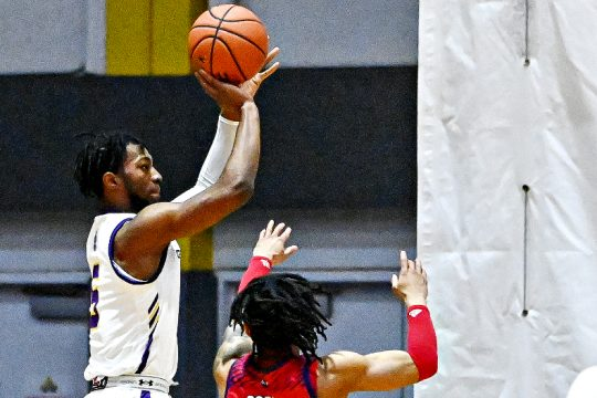 UAlbany's Jamel Horton, left, takes a shot during last Saturday's game at SEFCU Arena. (Bob Mayberger/UAlbany Athletics)