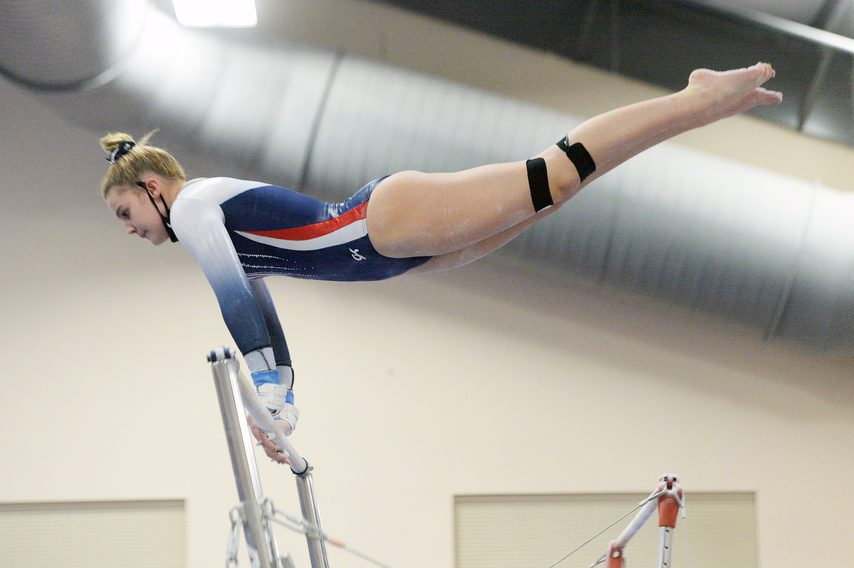 Angelina Damiano of Saratoga competes on the uneven bars during Friday's Suburban Council gymnastics meet with Guilderland at the Wilton YMCA.