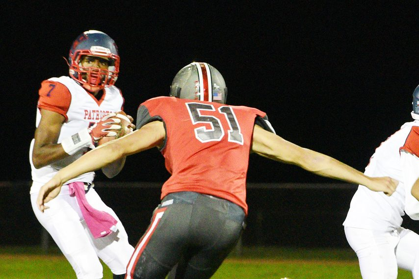 Schenectady quarterback Seven Terry looks to pass while Niskayuna'€™s Jack Rutland closes in during a football game from the 2019 season at Niskayuna High School.