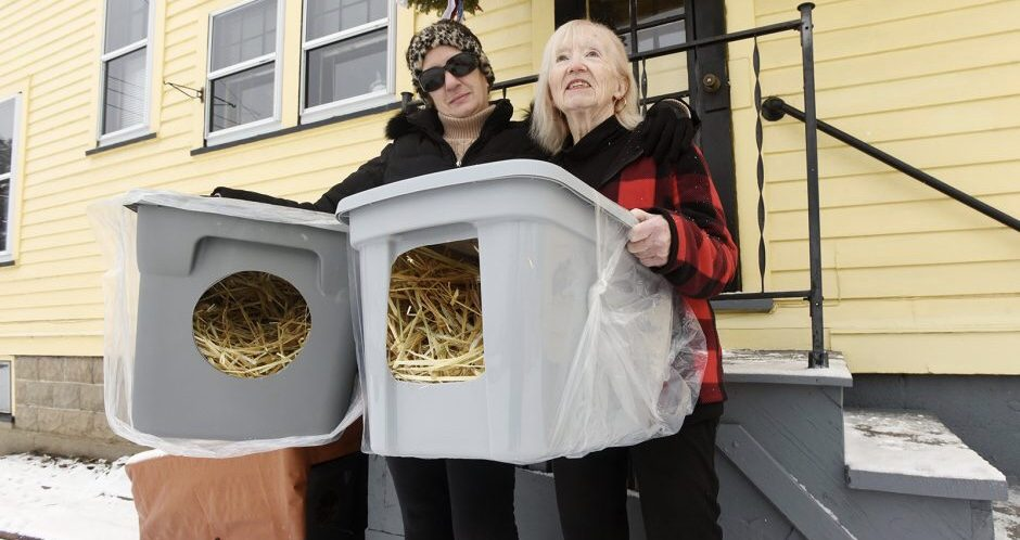 Angel Mariani, left, builder of feral cat shelters, along with friend and supporter, Adrienne Allen, show off several of the plastic shelters