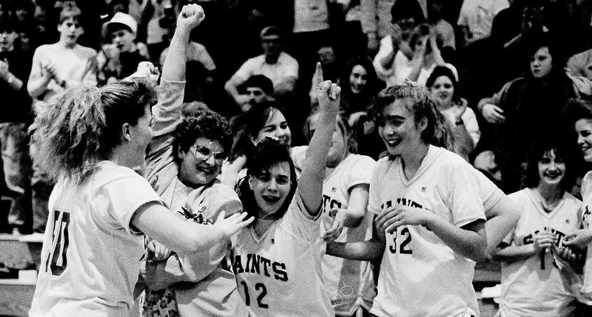 St. Johnsville basketball players celebrate their regional championship game over Westport (61-49) on March 9, 1991.