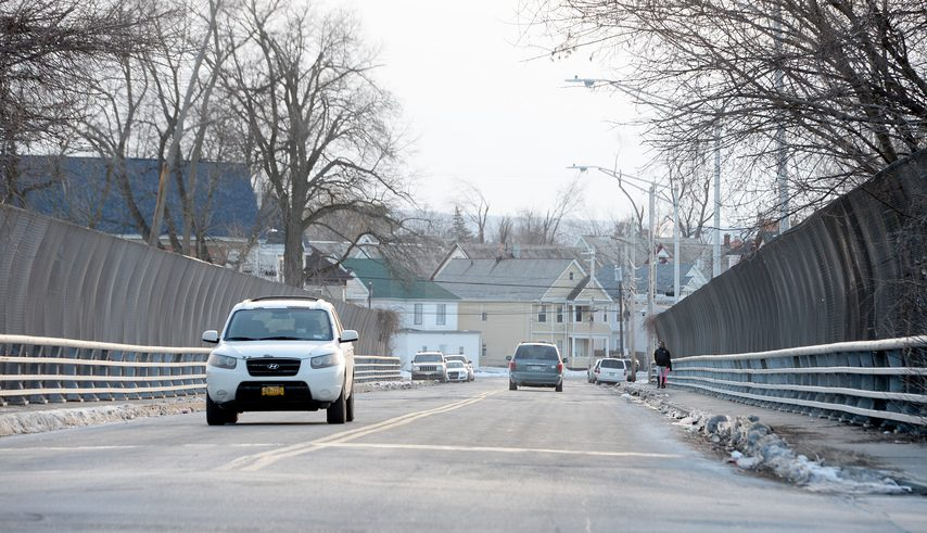 Cars drive over Cotton Factory Hollow Bridge on Francis Avenue in Schenectady on Monday.