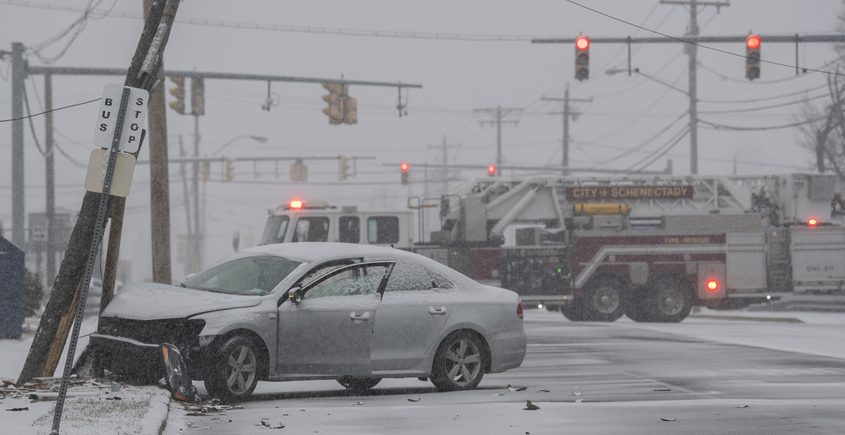 A Schenectady fire truck blocks State Street near Route 7 after a driver lost control and struck a pole Tuesday.