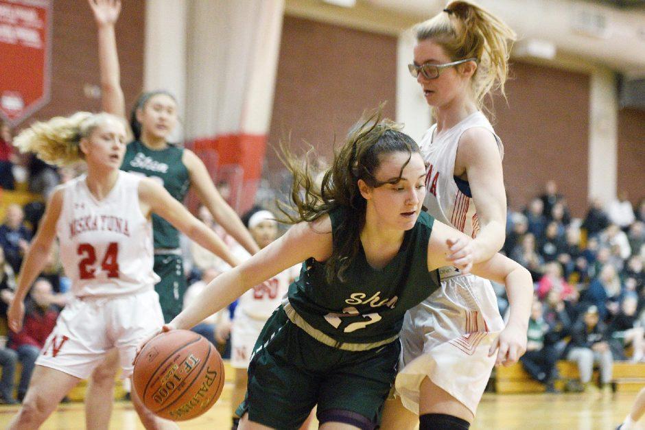 ERICA MILLER/THE DAILY GAZETTEShenendehowa's Kaitlyn Watrobski with the ball against Niskayuna's Emma Souky during their Suburban girls' basketball game Jan. 31, 2020, at Niskayuna High School.