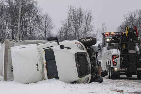 The tractor-trailer and tow truck Wednesday morning