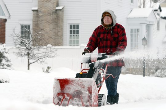 Tom Spaulding, off Grander Road, snow blows his neighbors sidewalks on 5th Ave after snowstorm overnight in Saratoga Springs Wednesday