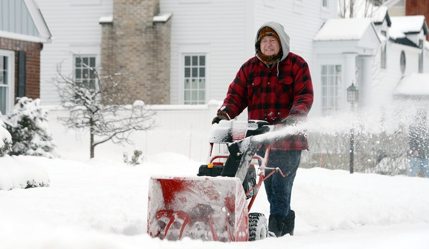 Tom Spaulding, off Grander Road, snow blows his neighbors sidewalks on 5th Ave after snowstorm overnight in Saratoga SpringsWednesday