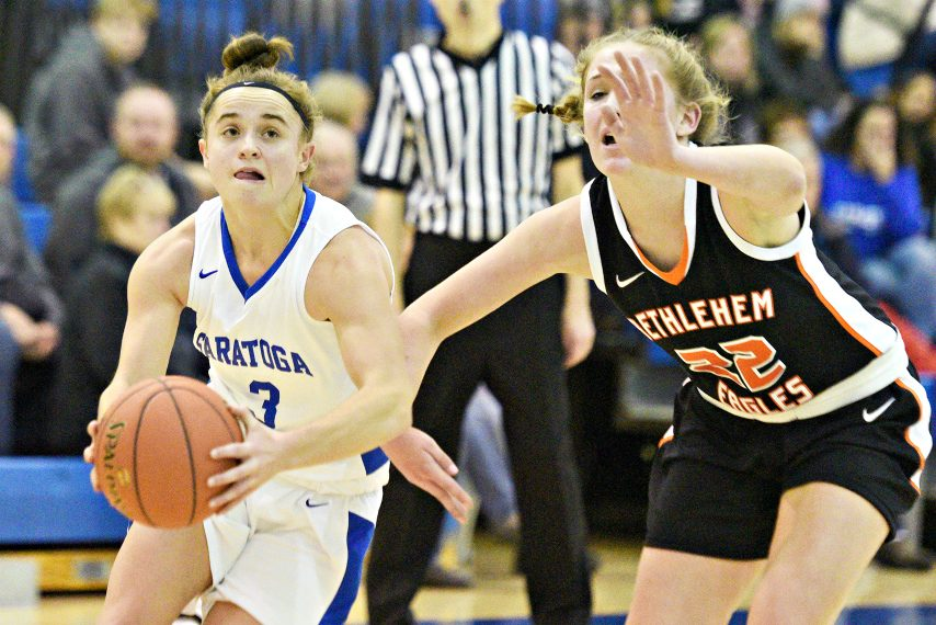 ERICA MILLER/THE DAILY GAZETTESaratoga Springs Dolly Cairns with the ball against Bethlehem's Caroline Wise during their high school basketball game at SSHS on Friday, January 3, 2020.
