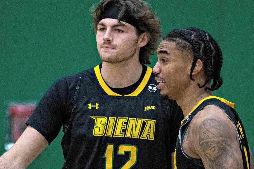 Siena's Kyle Young, left, and Manny Camper are shown during a game last weekend against Saint Peter's. (Peter R. Barber/The Daily Gazette)