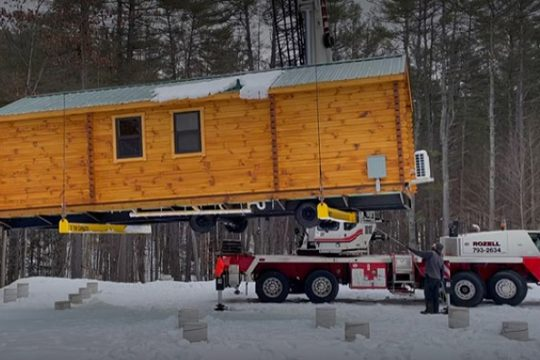 A crane lowers a new cabin onto piers at Luzerne Music Center in this photo taken from a recent video.