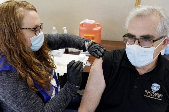 Robert Purtell of Amsterdam receives his first shot of the Moderna COVID vaccine Jan. 8.
