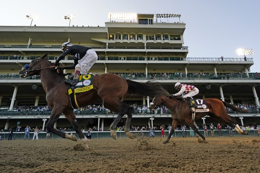 JEFF ROBERSON/THE ASSOCIATED PRESSAuthentic, left, beats Tiz the Law by1 1/4 lengths in the 2020 Kentucky Derby at Churchill Downs on Sept. 5.