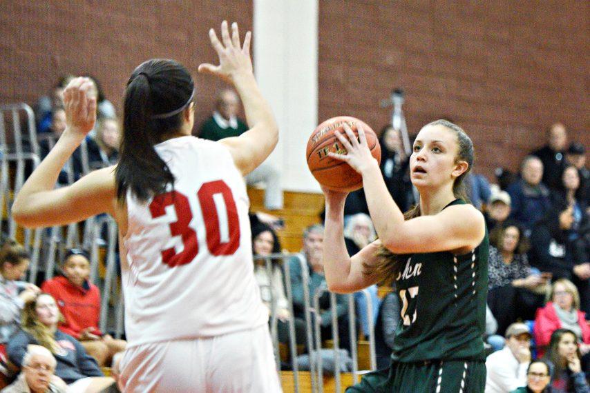 ERICA MILLER/THE DAILY GAZETTEShenendehowa's Meghan Huerter makes a shot against Niskayuna's Olivia Olsen during their high school basketball game at Niskayuna High School on Friday, January 31, 2020.