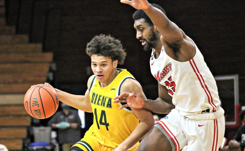 Siena's Jordan King, left, drives toward the basket during Saturday's loss at Marist. (Connor Giblin/Marist Athletics)