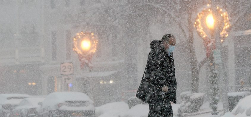 A man makes his way across Broadway in Saratoga Springs during snow last week