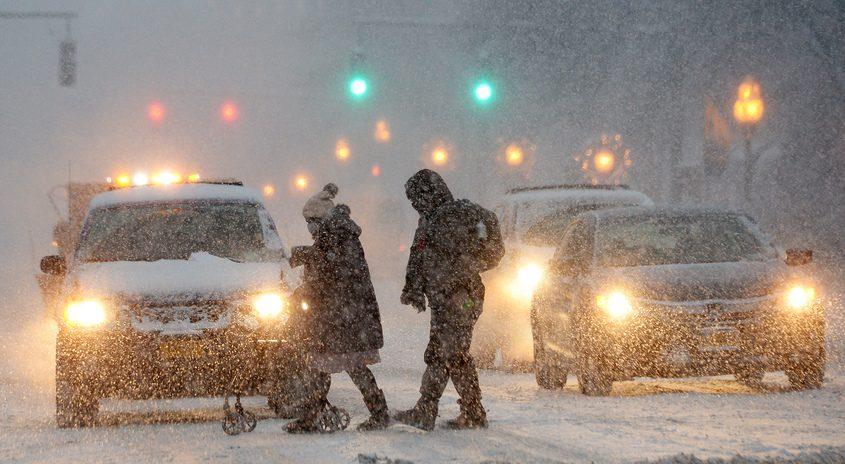 People make their way across Broadway in Saratoga Springs during snow last week.