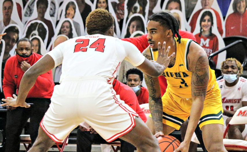 Siena's Manny Camper, right, is shown during Saturday's game at Marist. (Connor Giblin/MaristAthletics)